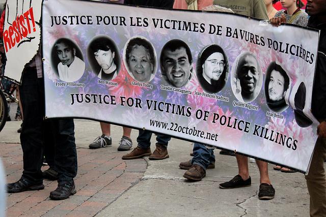 Montréal 17 août 2014 - Vigile en solidarité avec le soulèvement à Ferguson Crédit photo: blogocram, Flickr, CC BY-NC 2.0 https://www.flickr.com/photos/blogocram/14767739559/in/album-72157646162621057/
